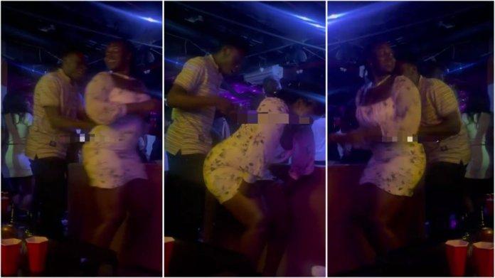 man pushes big booty lady away